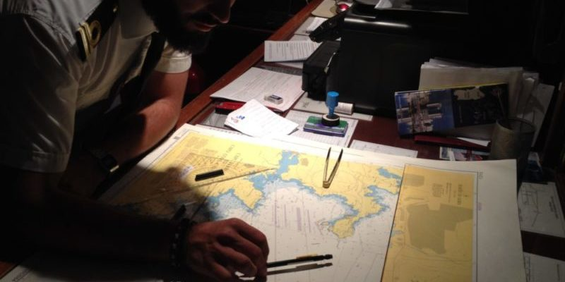 Studying itineraries on a nautical map